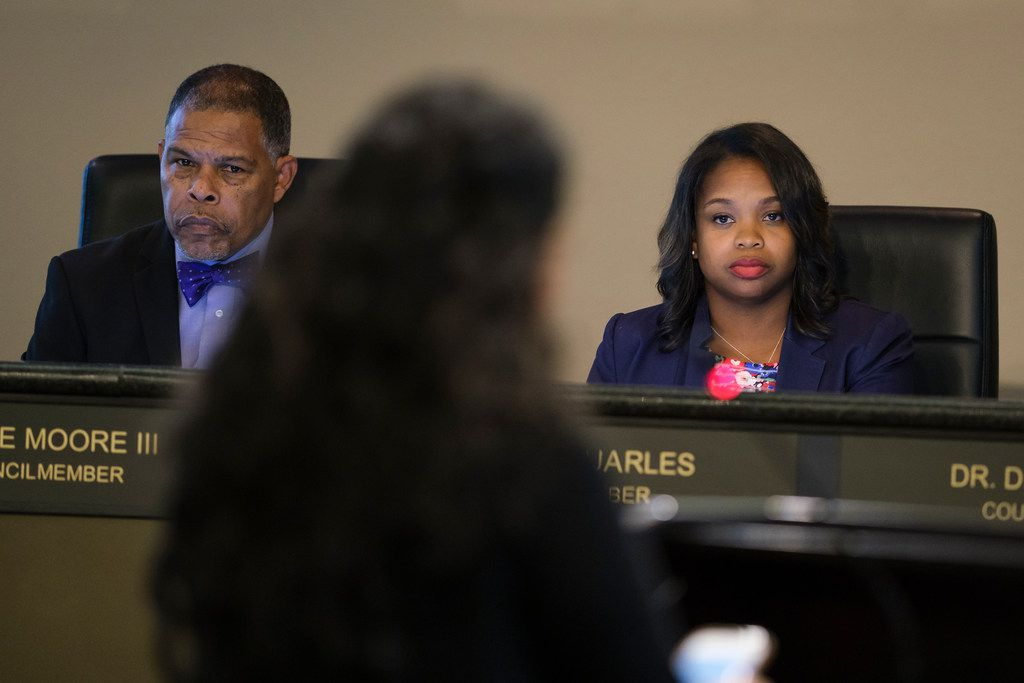 DeSoto Councilwoman Candice Quarles (right) faced more calls for her resignation during Tuesday night's meeting. Her fellow council members, including Mayor Pro Tem Kenzie Moore (left) again stayed silent despite residents' pleas for them to engage with the public on issues surrounding disclosures Quarles benefited from her husband's theft of public funds..