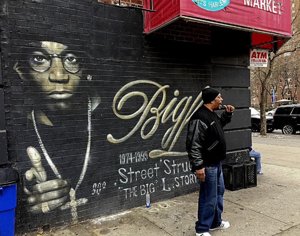 Grandmaster Caz pauses in front of a mural during the tour to reminisce about some fallen musical celebrities.