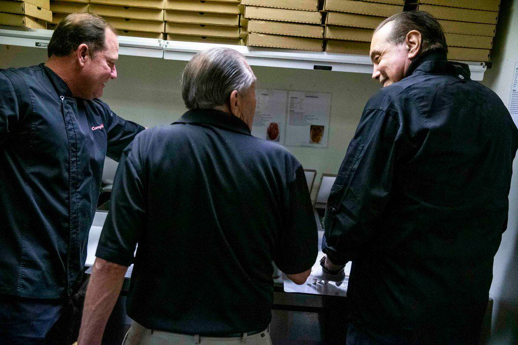 David Campisi (left) and Corky Campisi (middle) show actor Chazz Palminteri how to make pizza during a visit to Campisi's Egyptian Lounge.
