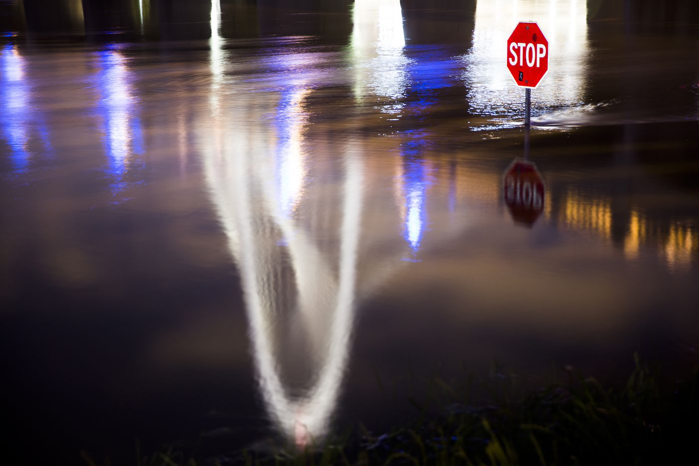 """The Margaret Hunt Hill Bridge reflected in the Trinity River, which was close to 40 feet, the level defined as """"major"""" flood stage, on May 24, 2015. The last time the Trinity River rose to 40 feet was June 28, 2007, when it crested at 40.25 feet. (Smiley N. Pool/The Dallas Morning News)"""