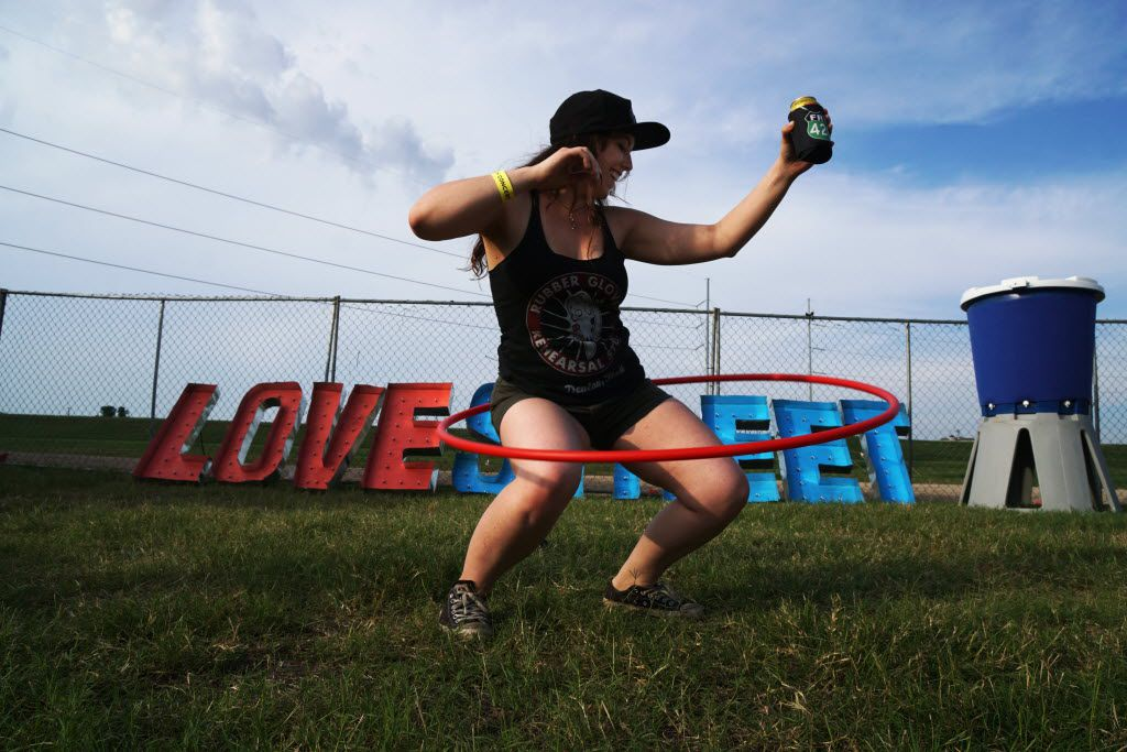 Ashlyn Thomas shows off her hula hoop skills at the Untapped Music & Beer Festival at Panther Island in Fort Worth, Texas on Saturday, June 11, 2016. Brewers and bands from all over the country participated.