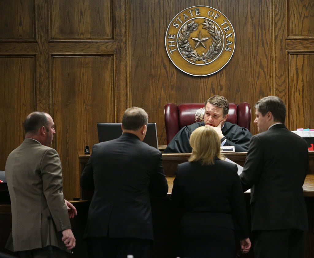 Court-appointed defense attorneys R. Shay Isham (left) and J. Warren St. John  meet at the bench with State District Judge Jason Cashon and Texas Attorney General's Office Assistant Attorney General Jane Starnes and Erath County District Attorney Alan Nash during the capital murder trial of former Marine Cpl. Eddie Ray Routh at the Erath County, Donald R. Jones Justice Center in Stephenville on Feb. 13, 2015. Routh was charged with the 2013 deaths of former Navy SEAL Chris Kyle and his friend Chad Littlefield at a shooting range near Glen Rose.