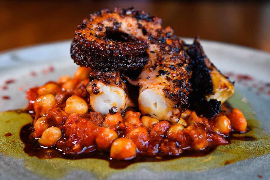Roasted octopus with chickpeas, chorizo and cherry tomato