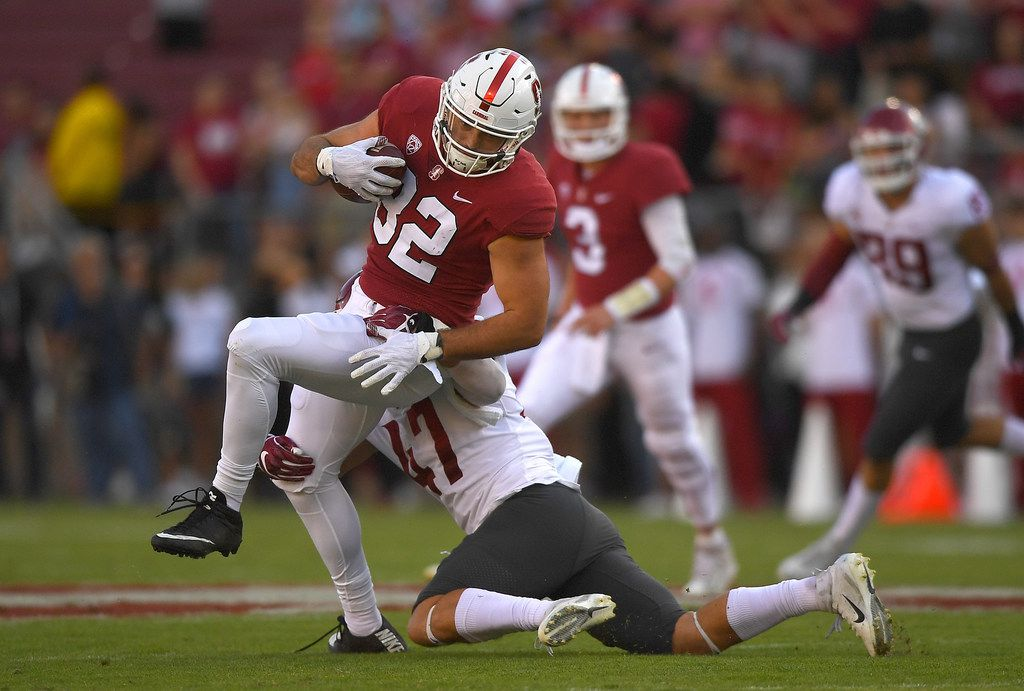 PALO ALTO, CA - OCTOBER 27:  Kaden Smith #82 of the Stanford Cardinal catches a pass and gets tackled by Peyton Pelluer #47 of the Washington State Cougars during the first half of their NCAA football game at Stanford Stadium on October 27, 2018 in Palo Alto, California.  (Photo by Thearon W. Henderson/Getty Images)
