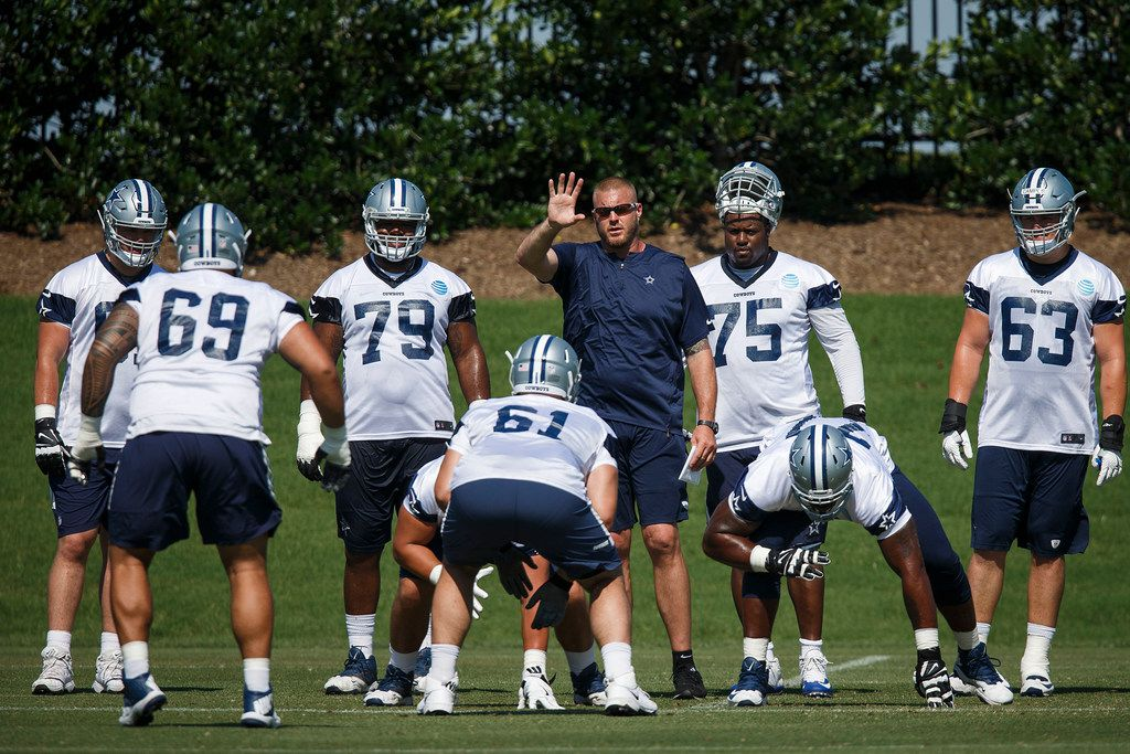 FILE - Cowboys assistant offensive line coach Marc Colombo works with lineman during the third and final round of Cowboys OTA practices at The Star on Wednesday, June 6, 2018, in Frisco. (Smiley N. Pool/The Dallas Morning News)