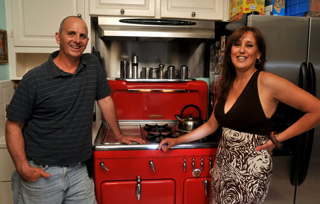Van and Elsa Moushegian with with their 1950s-era Chambers stove at their home in Dallas on June 4, 2010. The vintage, natural-gas stove features a top broiler and a deep-well slow cooker as well as innovative safety features