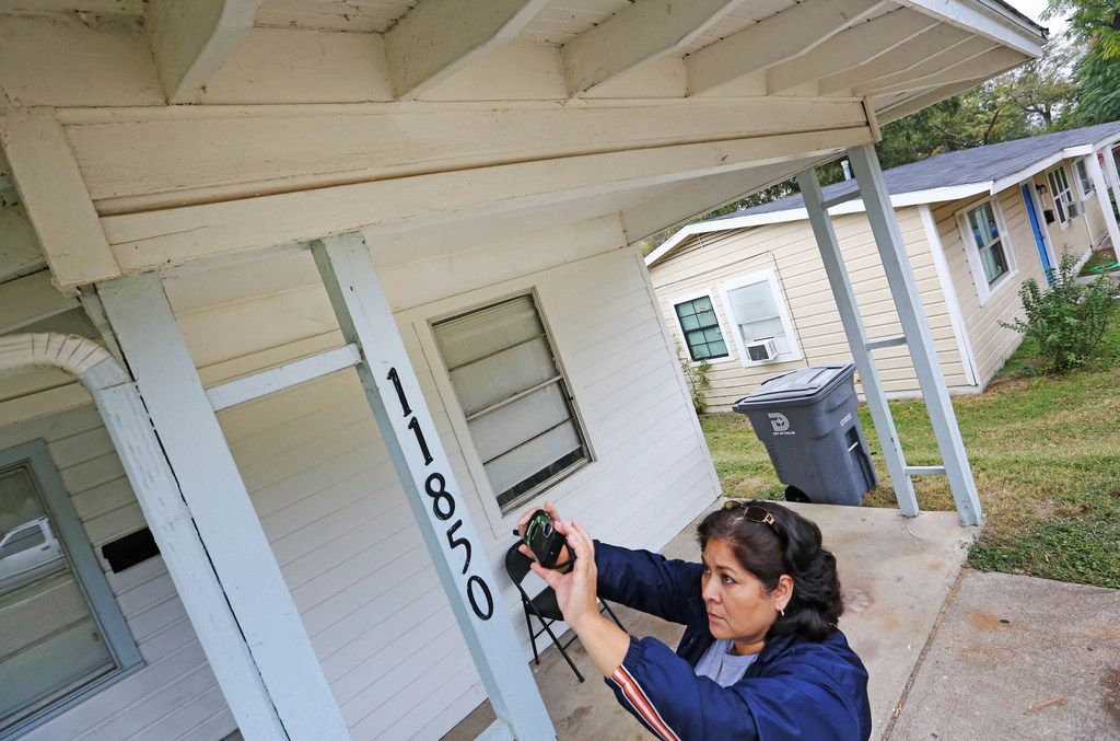 City of Dallas code inspector Diana Conde takes a photo of a repair that was done to the eaves as she conducts an inspection of a single-family home in North Dallas on Nov. 1.