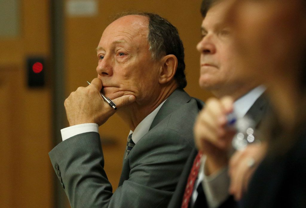 Defendant Robert Moses listened with defense attorney Toby Shook during Moses' trial at the Collin County Courthouse in McKinney on Oct. 25, 2016.