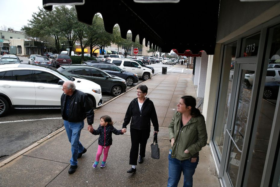 Dave Krainbucher (from left) walks with his granddaughter Charlotte Camp, 4, with his wife Kathy Krainbucher and daughter Joelle Camp after eating at Kuby's at Snider Plaza in Dallas on January 18, 2017.)