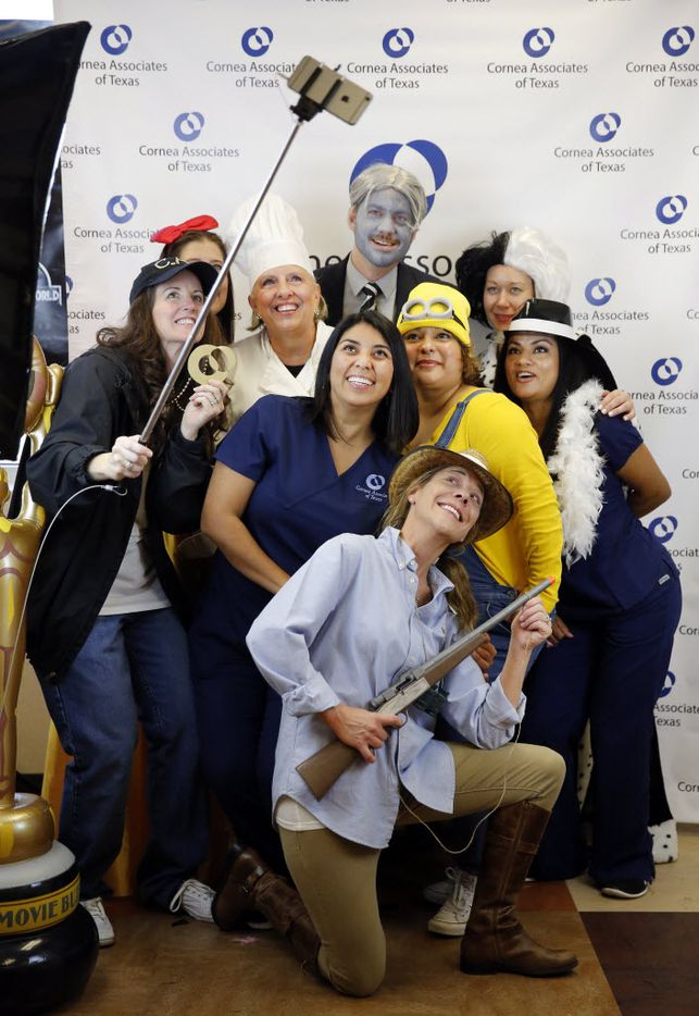 Cornea Associates of Texas team leaders, dressed as movie characters, pose for a selfie as part of Employee Appreciation Week.