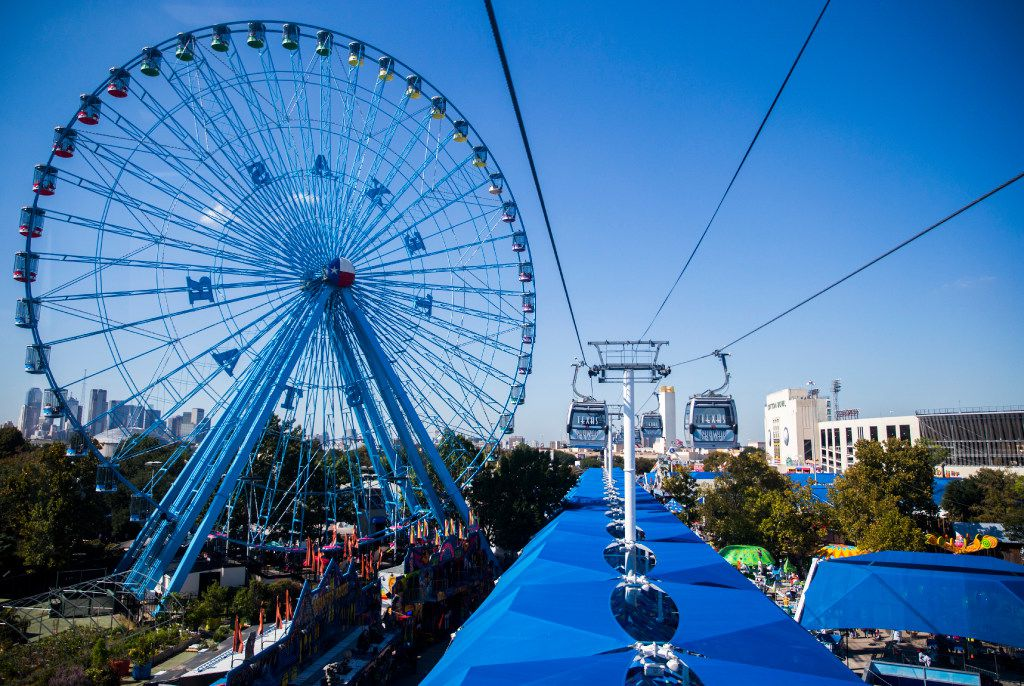 The Texas Star, the Midway, the Texas Skyway and the Cotton Bowl, as seen from the Texas Skyway at The State Fair of Texas on Tuesday, October 12, 2016 at Fair Park in Dallas. (Ashley Landis/The Dallas Morning News)