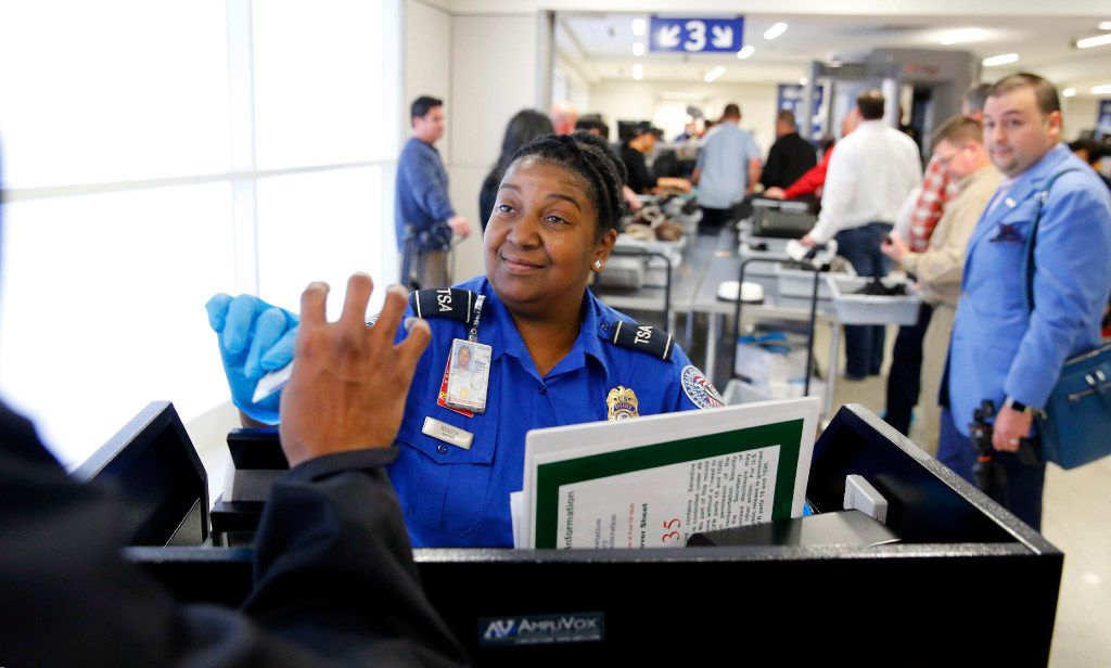 TSA agent Michelle Bender checked a person's license at the security checkpoint in Terminal A at Dallas-Fort Worth International Airport in 2017.