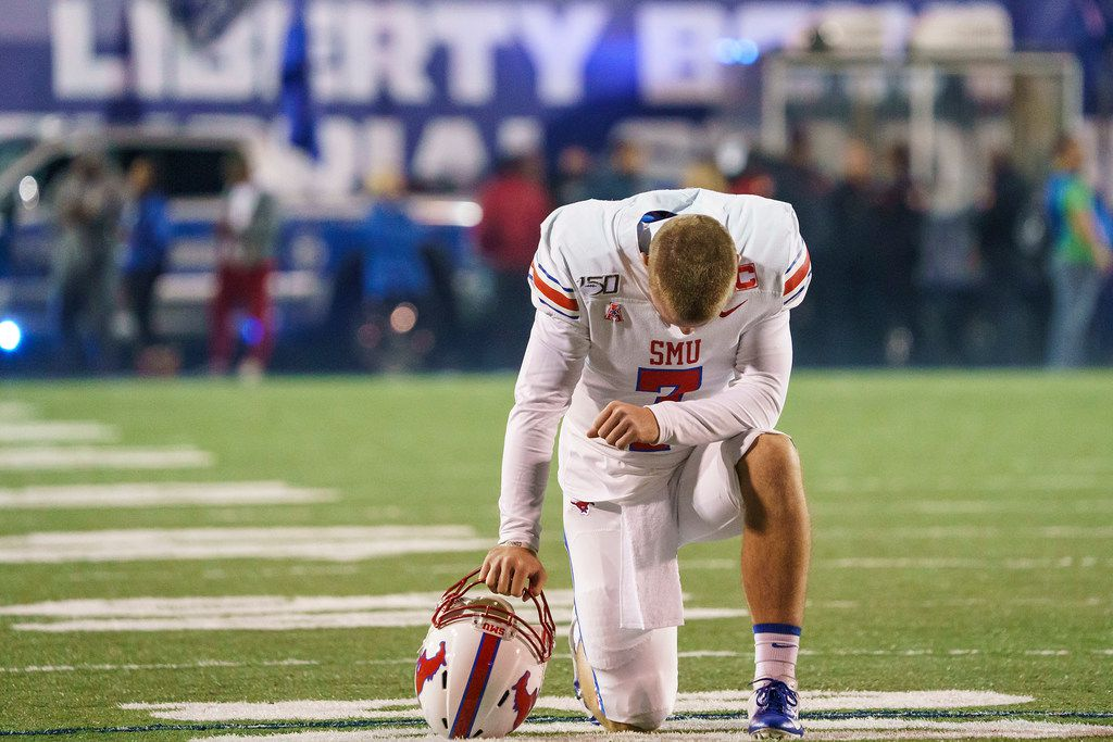 SMU quarterback Shane Buechele kneels in prayer before an NCAA football game against Memphis at Liberty Bowl Memorial Stadium on Saturday, Nov. 2, 2019, in Memphis, Tenn. (Smiley N. Pool/The Dallas Morning News)