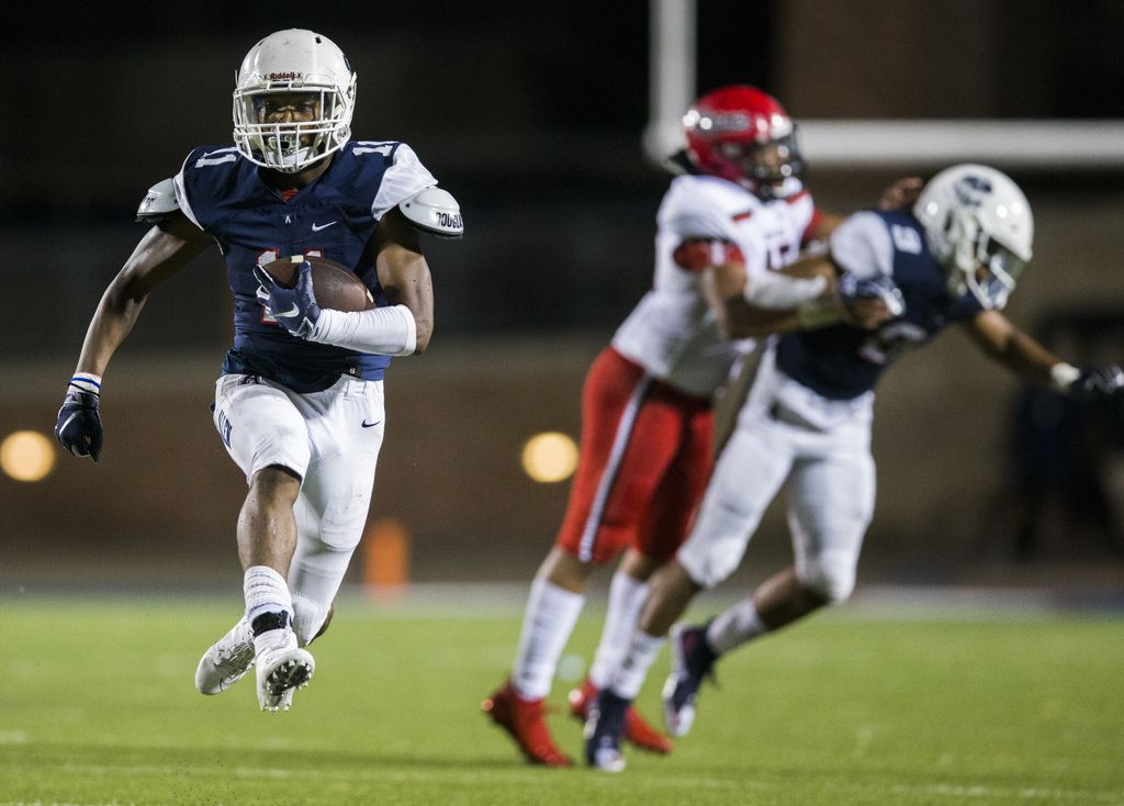 Allen running back Jordan Johnson (11) runs the ball during the fourth quarter of a high school football game between Allen and Cedar Hill on Friday, August 30, 2019 at Eagle Stadium in Allen. (Ashley Landis/The Dallas Morning News)