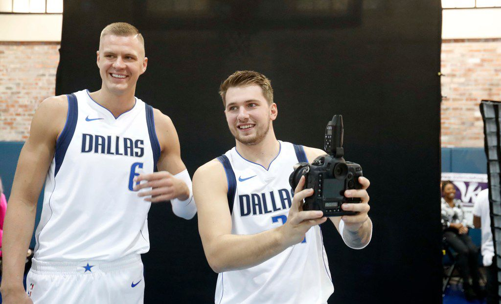 Dallas Mavericks Luka Doncic (77) of Slovenia and teammate Kristaps Porzingis of Latvia share a laugh during an NBA basketball media day in Dallas, Monday, Sept. 30, 2019. (AP Photo/LM Otero)