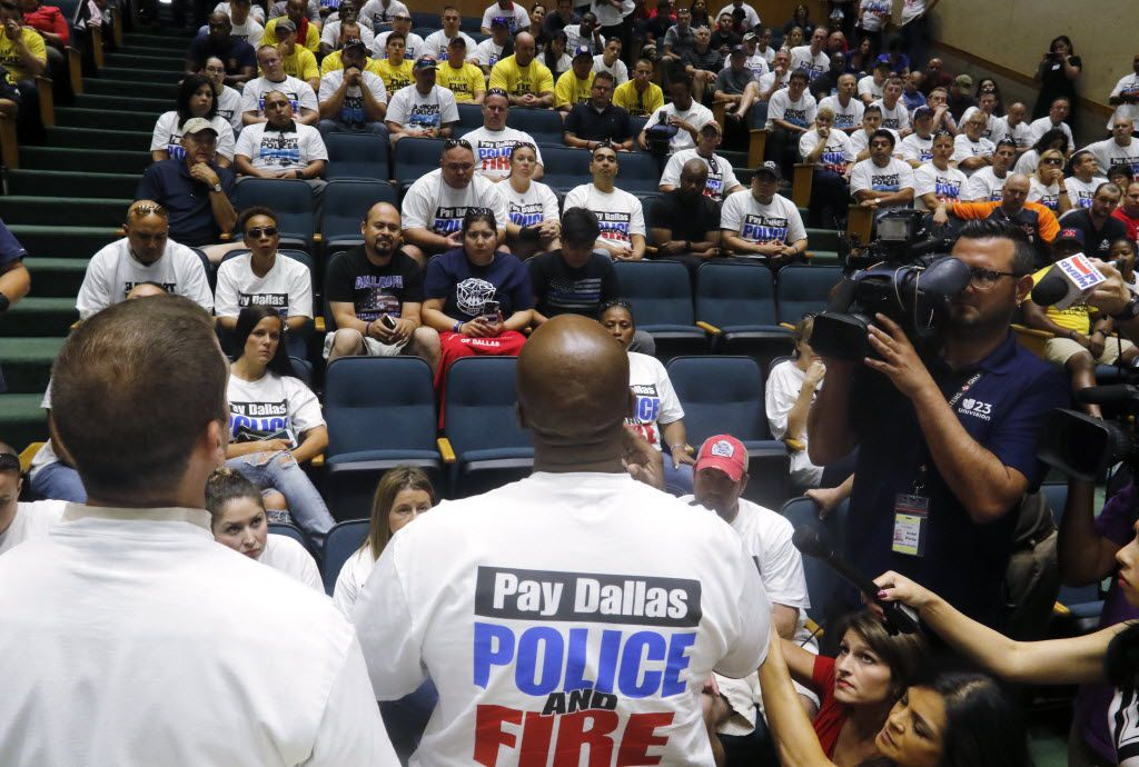 Dallas Firefighter Cristian Hinojosa, President, Dallas Hispanic Firefighters Association, left, and Sgt. Sheldon Smith, Dallas Police Association, spoke to Dallas police officers and first responders after a meeting at Dallas City Hall requesting a raise on August 3, 2016.