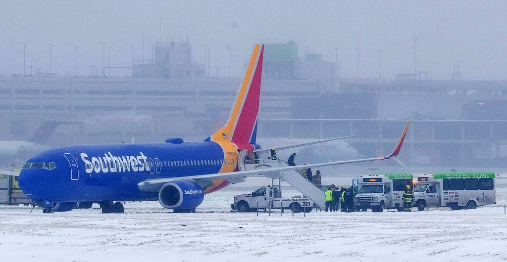 Passengers exit Southwest Airlines flight 1643 after the plane slid off the runway at Eppley Airfield Friday, Jan 18, 2019, in Omaha, Neb. (Ryan Soderlin/Omaha World-Herald via AP)