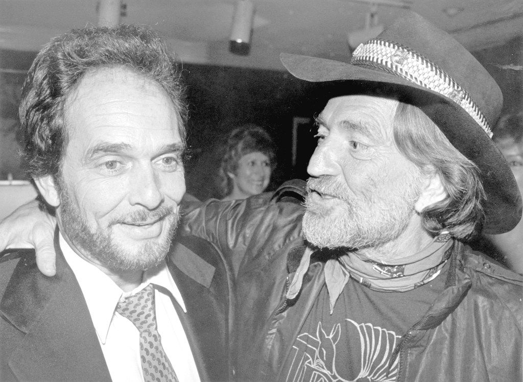 Merle Haggard (left) and Willie Nelson attend the BMI awards dinner in Nashville in Oct. 1981. (Los Angeles Times/TNS)