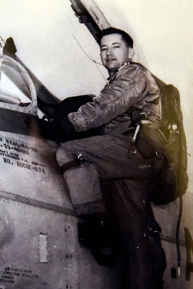 Air Force veteran Jorge Masek is shown with one of the planes he flew in the Korean War. The photo is on display at the Treemont Retirement Community.