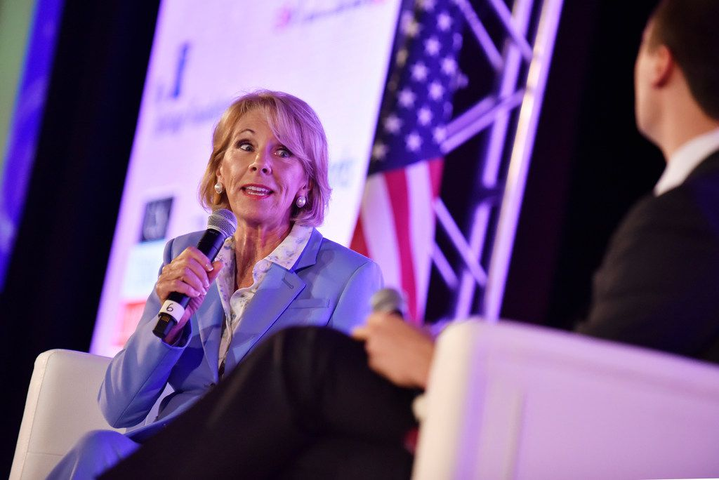 U.S. Secretary of Education Betsy DeVos spoke to Charlie Kirk, founder and executive director of Turning Point USA, during Young Women's Leadership Summit at the Hyatt Regency Hotel in downtown Dallas on Thursday.