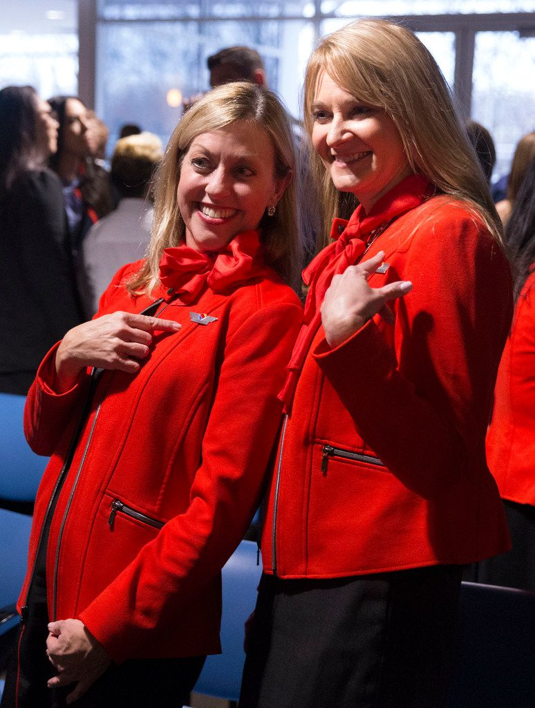 Southwest Airlines flight attendants Shari Rood (left) and Linda Clark pose for a photo after Rood earned her wings at the Southwest Airlines Training and Operational Support building in Dallas. Clark, who has been friends with Rood since high school, gave Rood her wings.