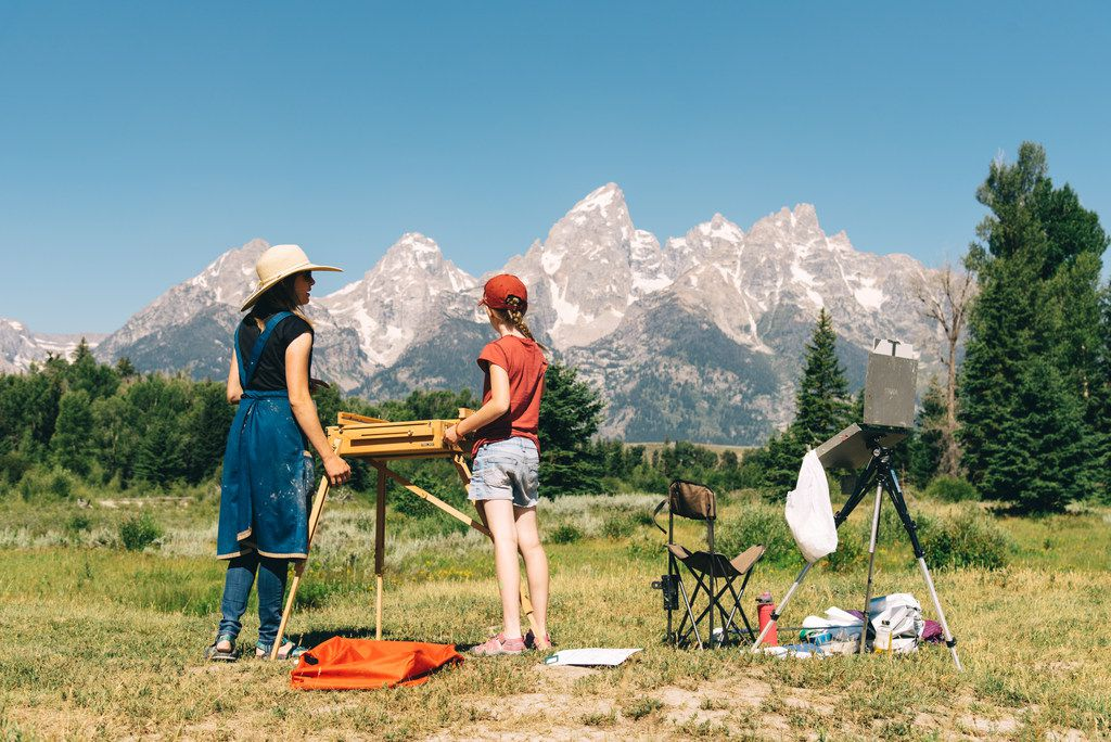 Visitors find an iconic scene to paint with the Grand Tetons near Jackson Hole, Wyo.
