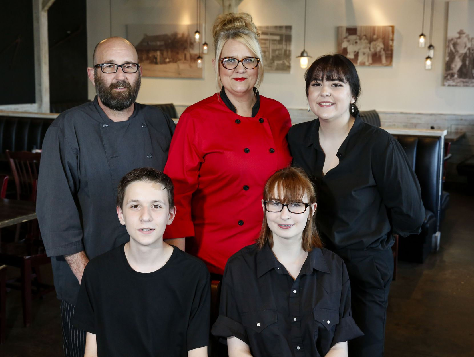 Owner and Executive Chef Phil Doyal, back row left, his wife owner and Pastry Chef Christina Doyal, back row center, their daughter Chloe Doyal, back row right, their son Keagan Doyal, front row left and daughter Peyton Doyal at the Barn Light Eatery in Frisco, Texas Thursday September 26, 2019.(Brian Elledge/The Dallas Morning News)