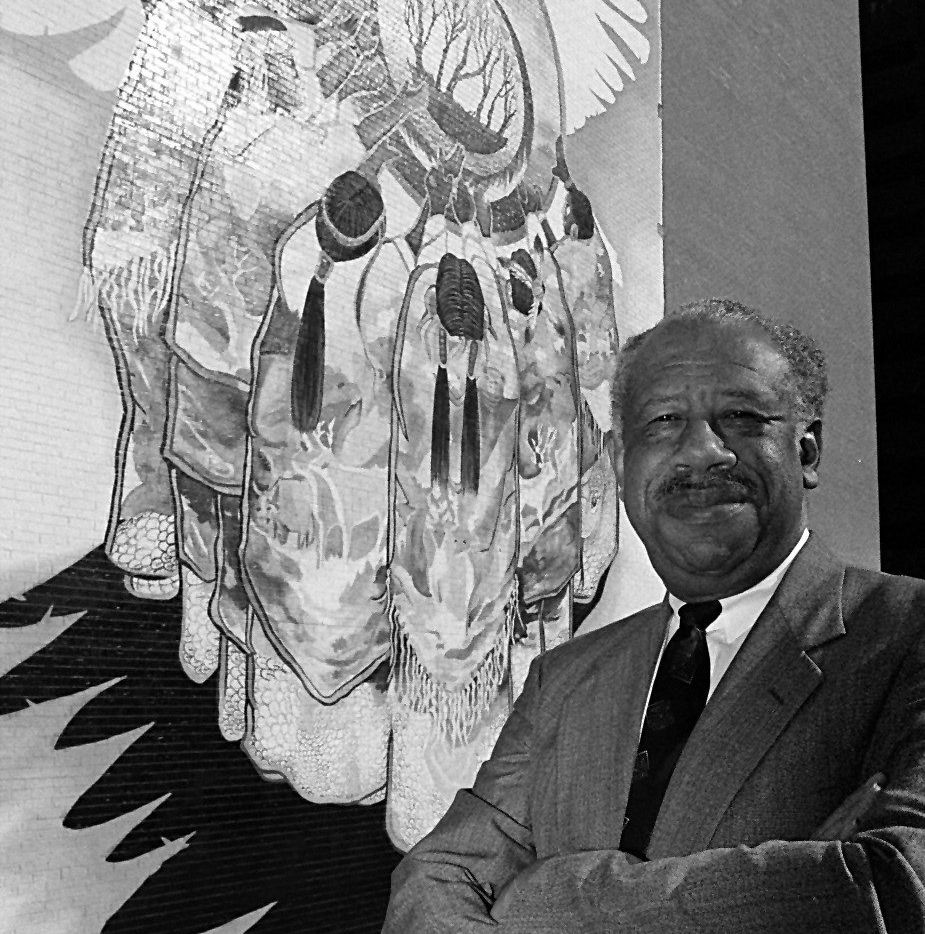 Wright Lassiter Jr. was president of Bishop College in the  1980s. Here he is photographed next to a Native American mural painted on one of the outside walls at the site, which is now Paul Quinn College.