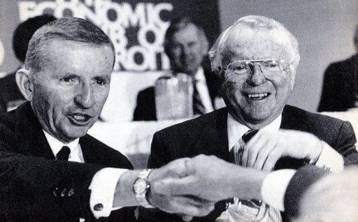 December 9, 1986 - H. Ross Perot (left) and General Motors Chairman Roger B. Smith are seen at a luncheon sponsored by the Economic Club of Detroit.