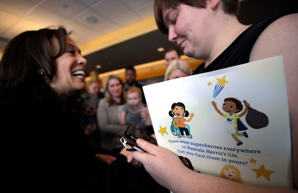 Sen. Kamala Harris of California met with a supporter who was carrying her children's book during a campaign stop in February in Concord, N.H. The Democratic presidential hopeful's book is called Superheroes Are Everywhere.