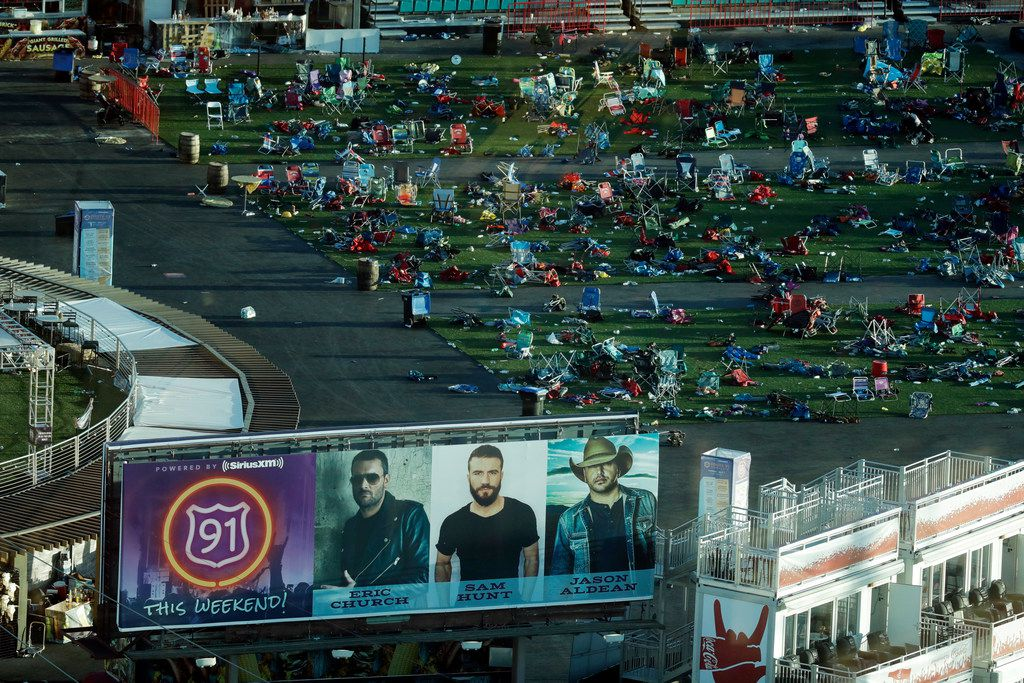 Debris litters a festival grounds across the street from the Mandalay Bay resort and casino Tuesday, Oct. 3, 2017, in Las Vegas.