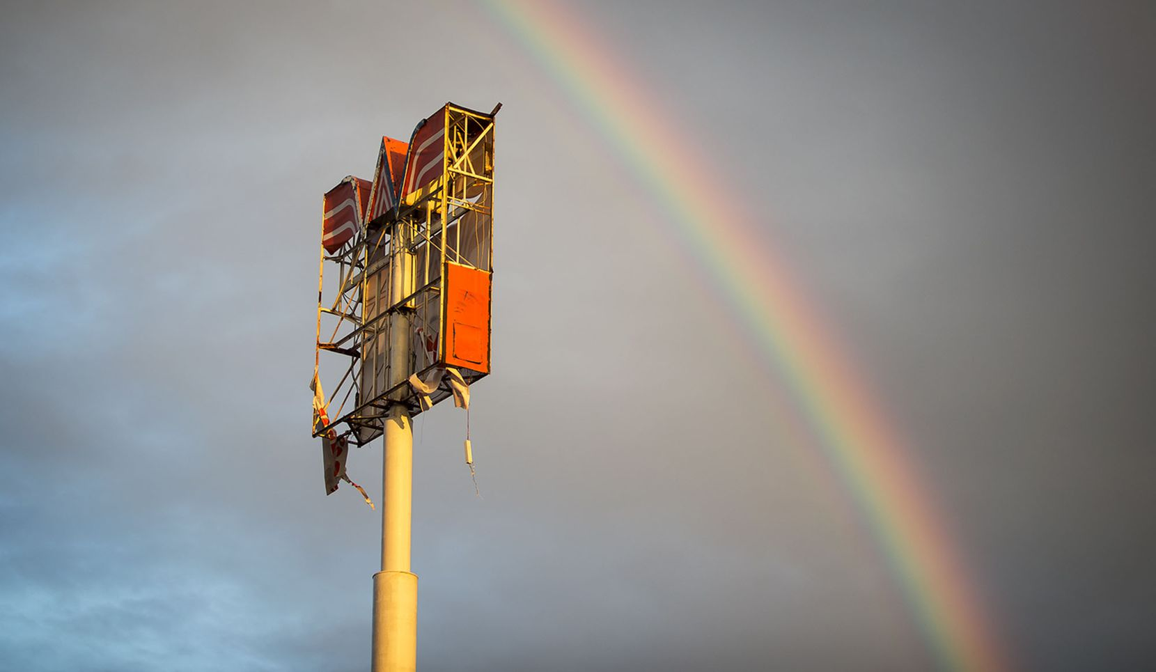A rainbow appears over over a Whataburger sign that was destroyed by Hurricane Harvey in Refugio, Texas, Monday, Aug. 28, 2017. (Nick Wagner/Austin American-Statesman via AP)
