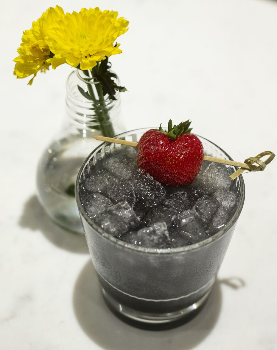 Flower Child's Black Rose cocktail is blended with vodka, elderflower, rose petal and Texas activated charcoal. It is light gray because of charcoal.