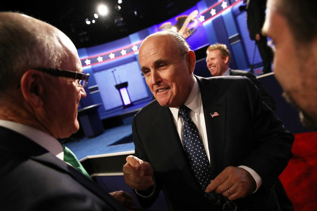 Former New York City mayor Rudy Giuliani speaks with guests before the start of the third U.S. presidential debate at the Thomas & Mack Center on October 19 in Las Vegas, Nevada.