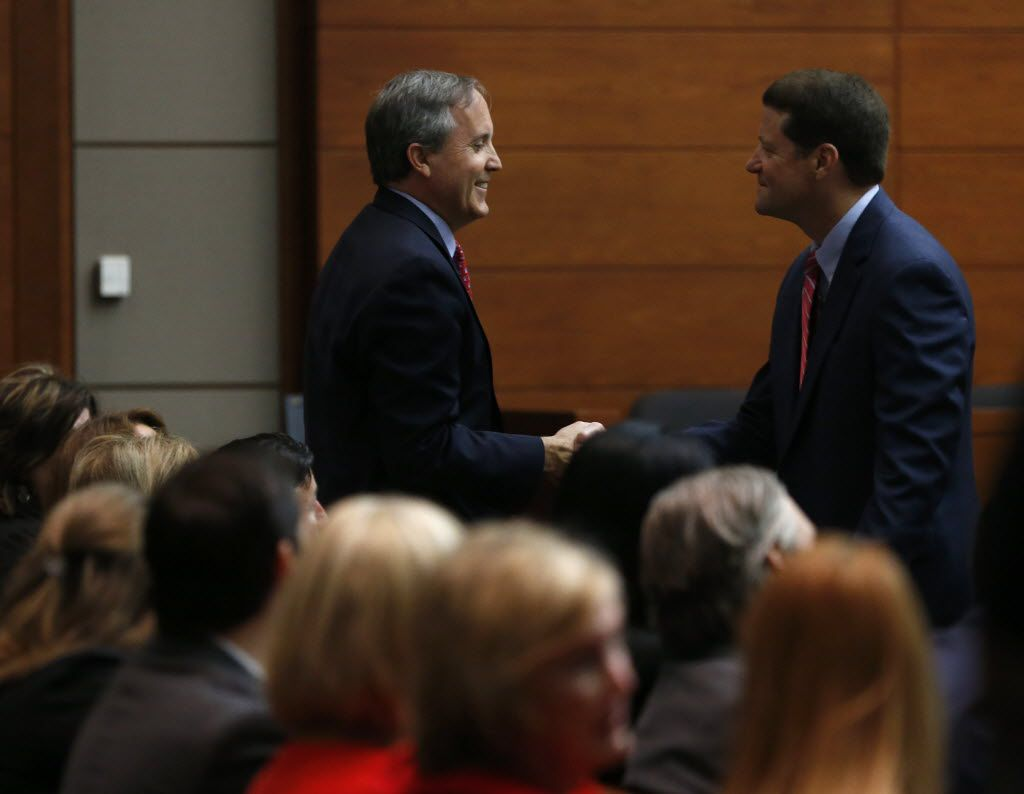 Texas Attorney General Ken Paxton shakes hands with his attorney Bill Mateja after entering the Merrill Hartman Courtroom in the Fifth Court of Appeals at the George Allen Courts Building in Dallas on May 12, 2016. Paxton appeared in court to fight his three felony fraud indictments. (Rose Baca/The Dallas Morning News)