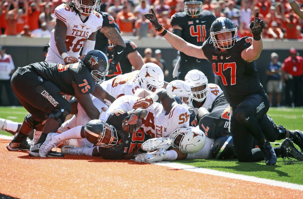 STILLWATER, OK - OCTOBER 1 :  Tight end Blake Jarwin #47 reacts to running back Barry J. Sanders #26 of the Oklahoma State Cowboys touchdown against the Texas Longhorns October 1, 2016 at Boone Pickens Stadium in Stillwater, Oklahoma. The Cowboys defeated the Longhorns 49-31.  (Photo by Brett Deering/Getty Images)