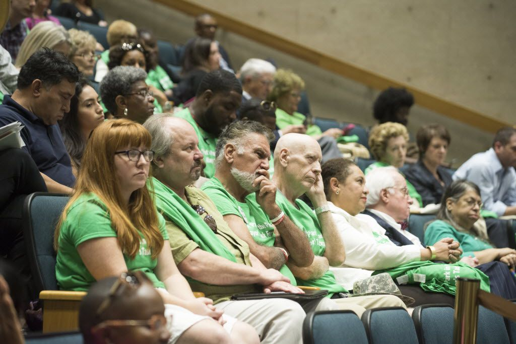 People opposed to Walt Humann's plan wore green shirts to the council meeting Monday.