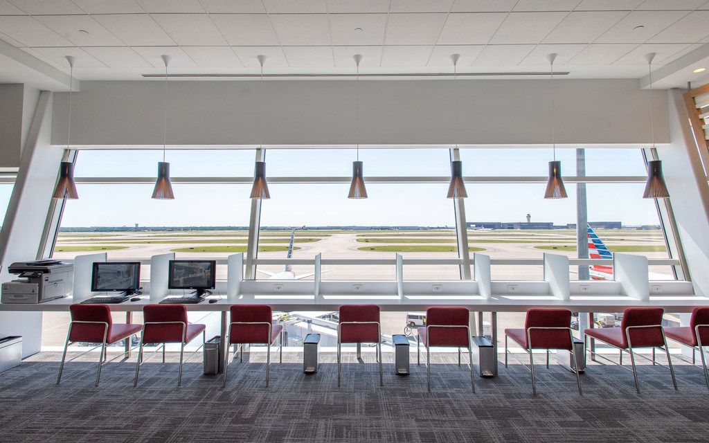 A business seating area overlooks the tarmac in the new American Airlines Flagship Lounge on Monday, May 13, 2019 in Terminal D at DFW Airport in Grapevine, Texas. (Jeffrey McWhorter/Special Contributor)