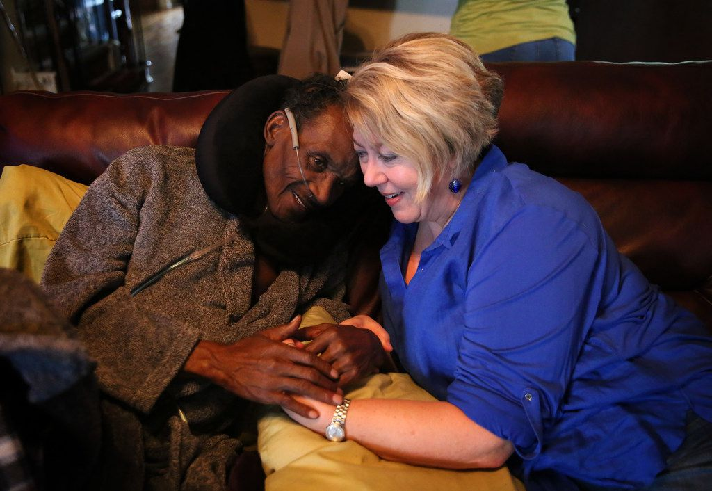 Michelle Moore (right), the attorney who helped to exonerate Johnnie Lindsey (left), a Texas exoneree who spent 26 years in prison for a crime he didn't commit, shares a moment with him at his home in Dallas just days before he died in February.