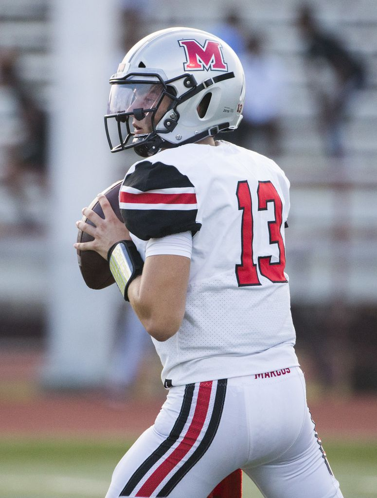 Flower Mound Marcus quarterback Garrett Nussmeier (13) looks for a receiver during the first quarter of a high school football game between Flower Mound Marcus and Arlington Bowie on Thursday, August 29, 2019 at Wilemon Field in Arlington. (Ashley Landis/The Dallas Morning News)