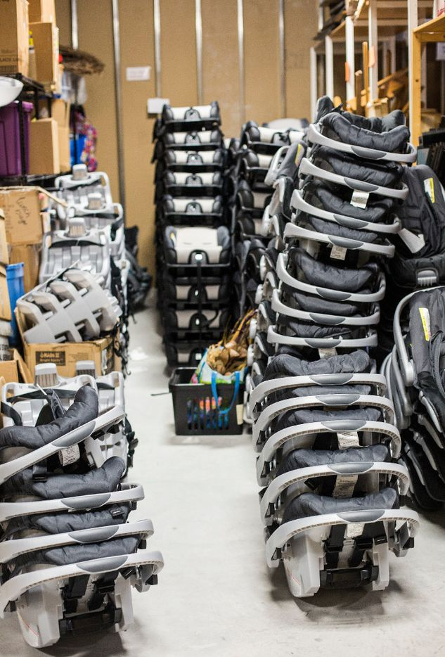 """Piles of car seats are prepared in Austin for shipment to a Houston """"Rainbow Room, """" which helps CPS workers assist abused and neglected children and their families. (Thao Nguyen/Special Contributor)"""