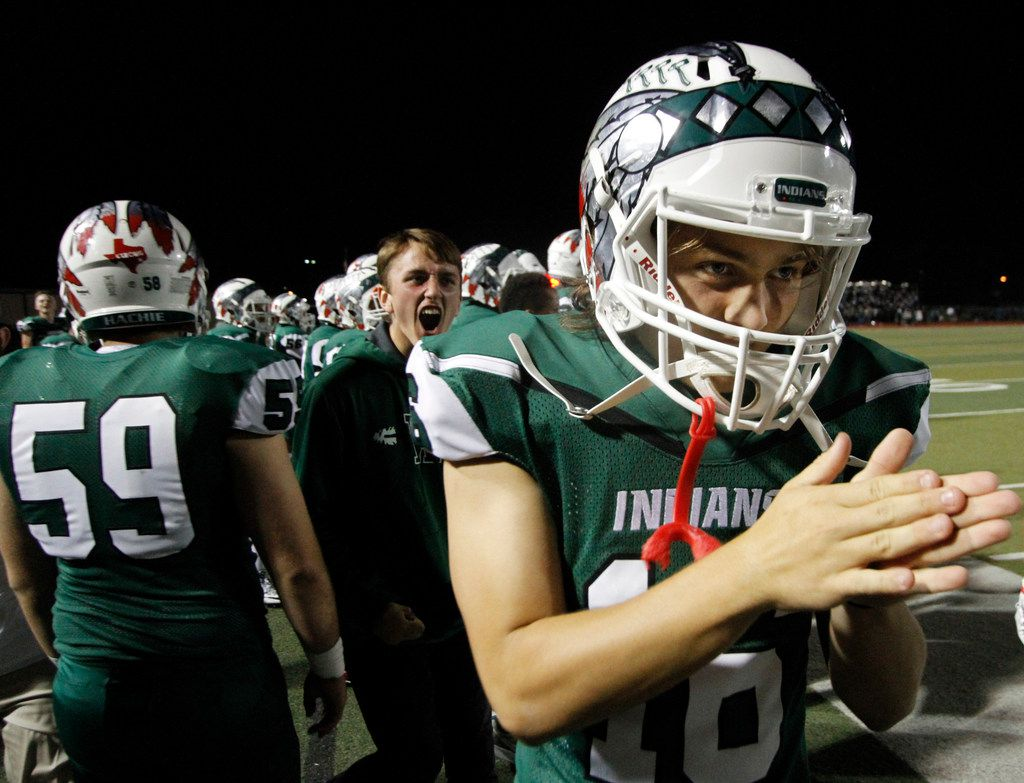 Waxahachie Indians sophomore quarterback Mason Brewer (16) rubs his hands together in anticipation of a big celebration from the team sidelines as the final seconds played out in their 30-16 come-from-behind victory over Lancaster. The win granted the Indians a playoff berth. The two teams played their District 10-5A football game at  Lumpkins Stadium in Waxahachie on November 3, 2017. (Steve Hamm/Special Contributor)