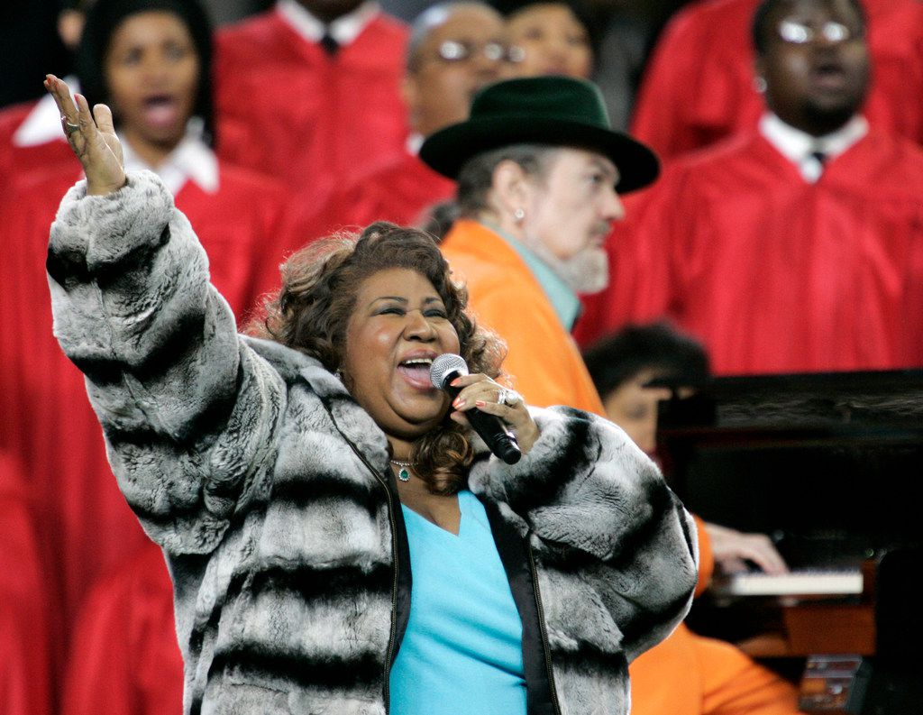 FILE - In this Feb. 5, 2006 file photo, Aretha Franklin and Dr. John, background on piano, perform the national anthem before the Super Bowl XL football game in Detroit.  Franklin died Thursday, Aug. 16, 2018 at her home in Detroit.  She was 76.