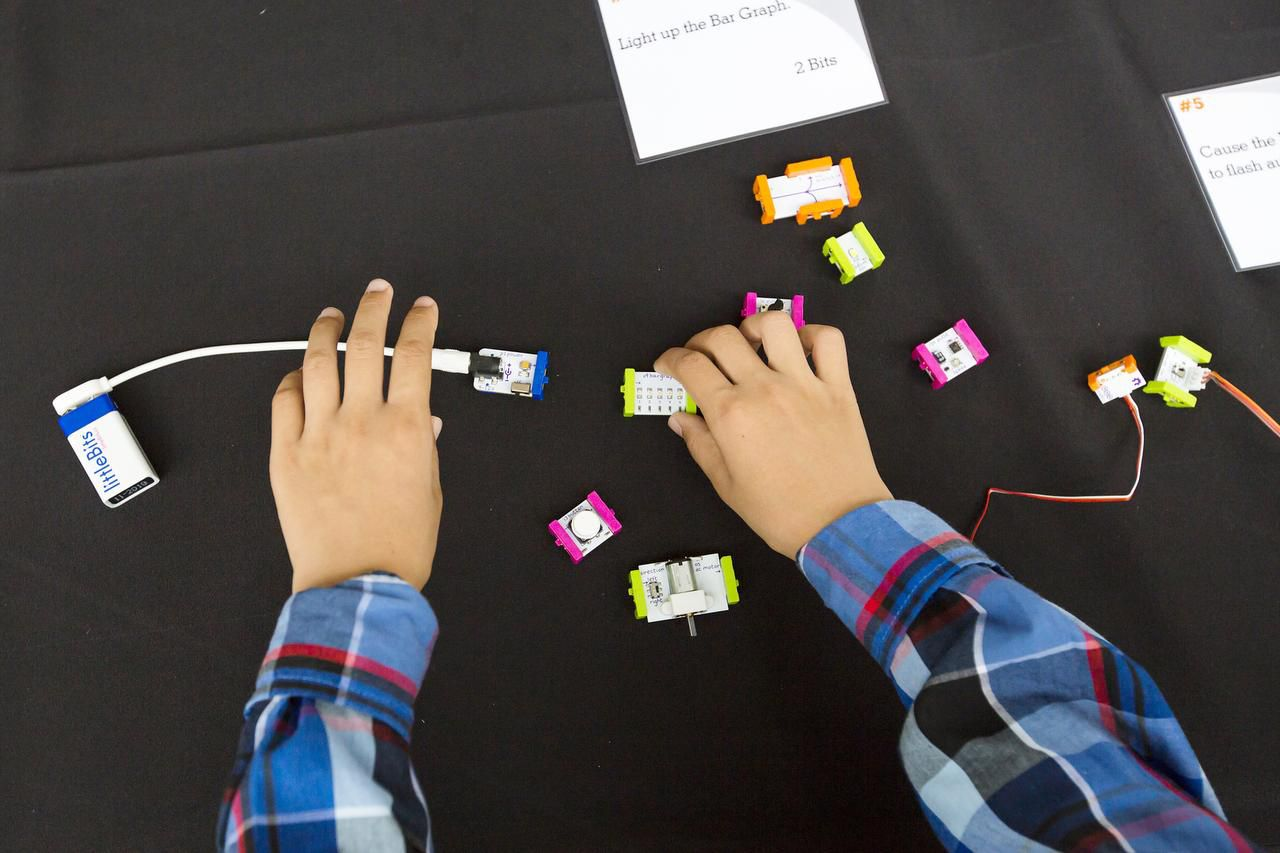 A youngster   learned  about electrical conductivity Saturday at the City of Learning kickoff at Klyde Warren Park.
