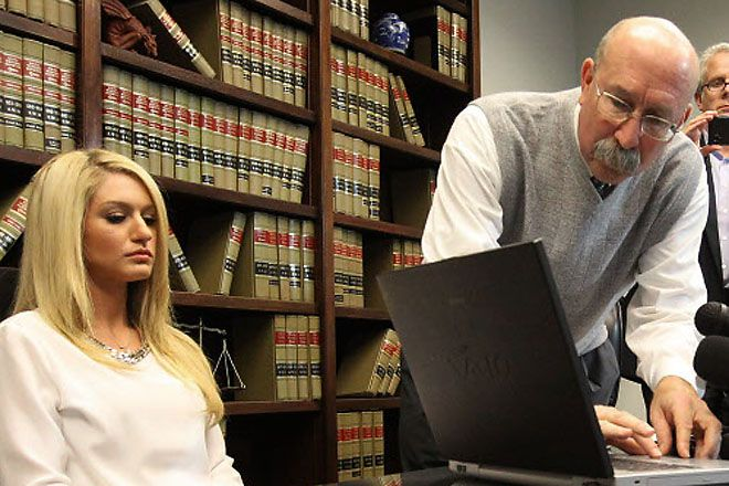 Maggie Strother (left), the ex-girlfriend of State District Judge Carlos Cortez, and her attorney Ted Steinke are seeking to have a special prosecutor examine the Dallas County District Attorney's office's handling of an assault case against Cortez after a grand jury declined to indict him last week.