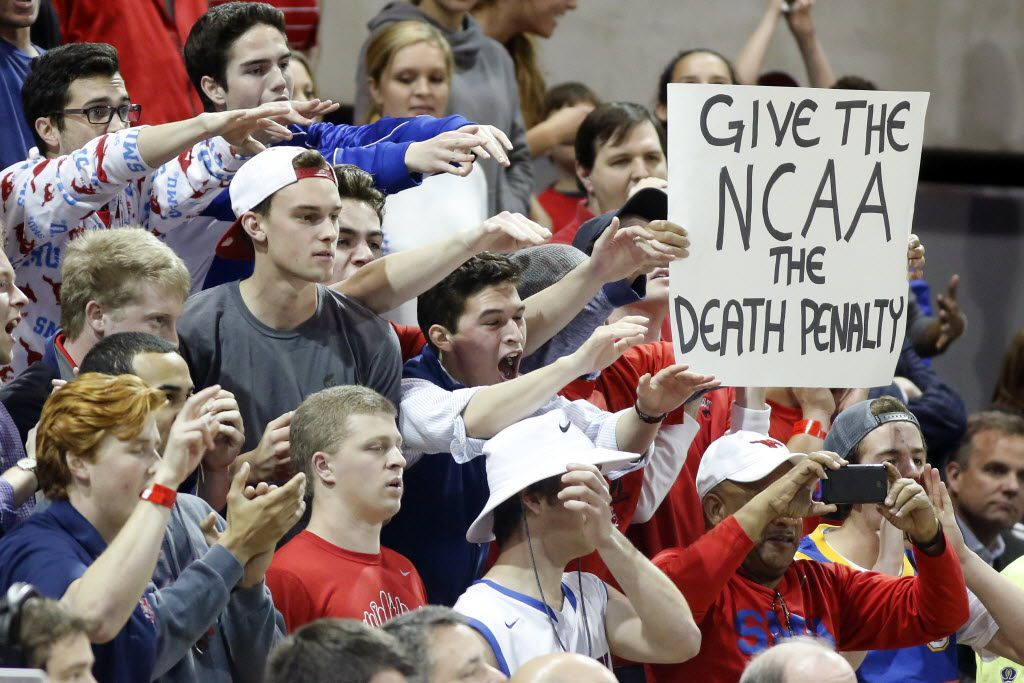 Southern Methodist Mustangs students cheer their team as they continue express their feelings toward the NCAA during the second half at Moody Coliseum in University Park, Texas, Thursday, February 19, 2015. SMU came from behind to win, 67-58.