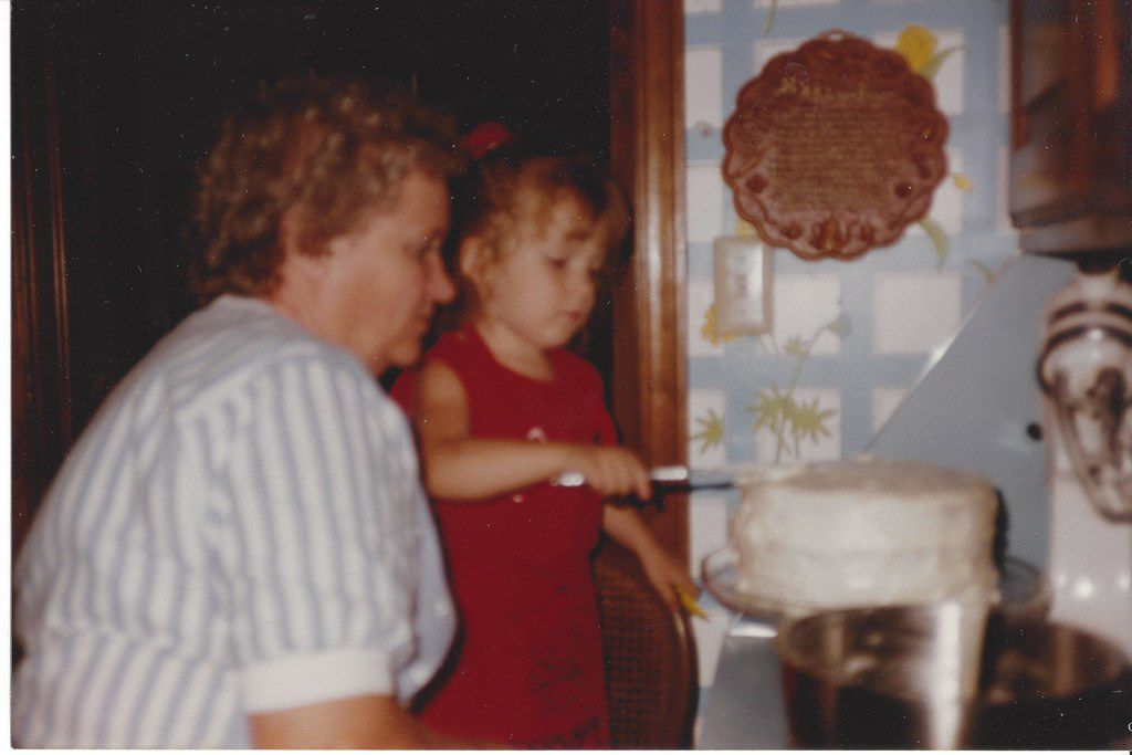 Nancy McCall, Nanette Light's grandmother, watches as Light ices her fourth birthday cake in 1991 during a birthday celebration at McCall's home in Norman, Okla. (Provided by Nanette Light)