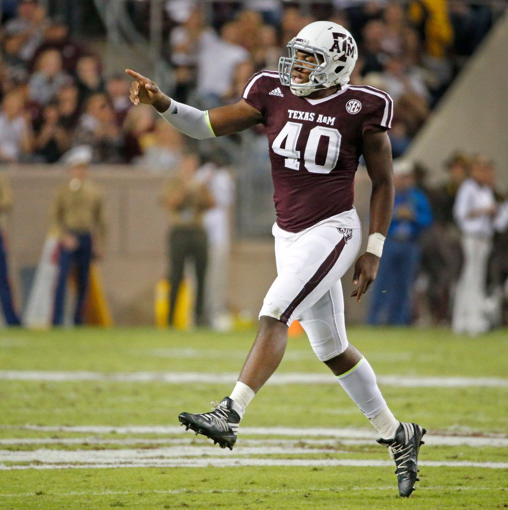 Texas A&M Aggies defensive lineman Jarrett Johnson (40) celebrates a defensive stop in the first quarter during the Ole Miss Rebels vs. the Texas A&M Aggies NCAA football game at Kyle Field in College Station, Texas on Saturday, November 12, 2016. (Louis DeLuca/The Dallas Morning News)