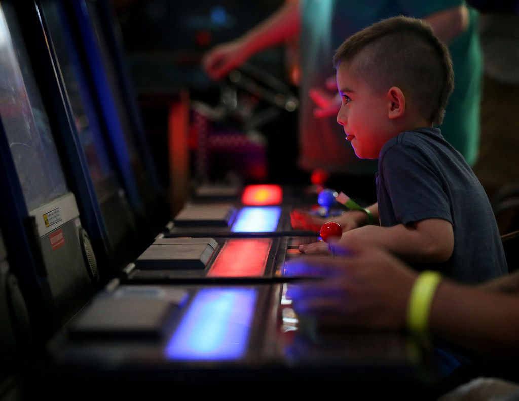 Valor Williams, 5, plays a video game at Cidercade in Dallas.