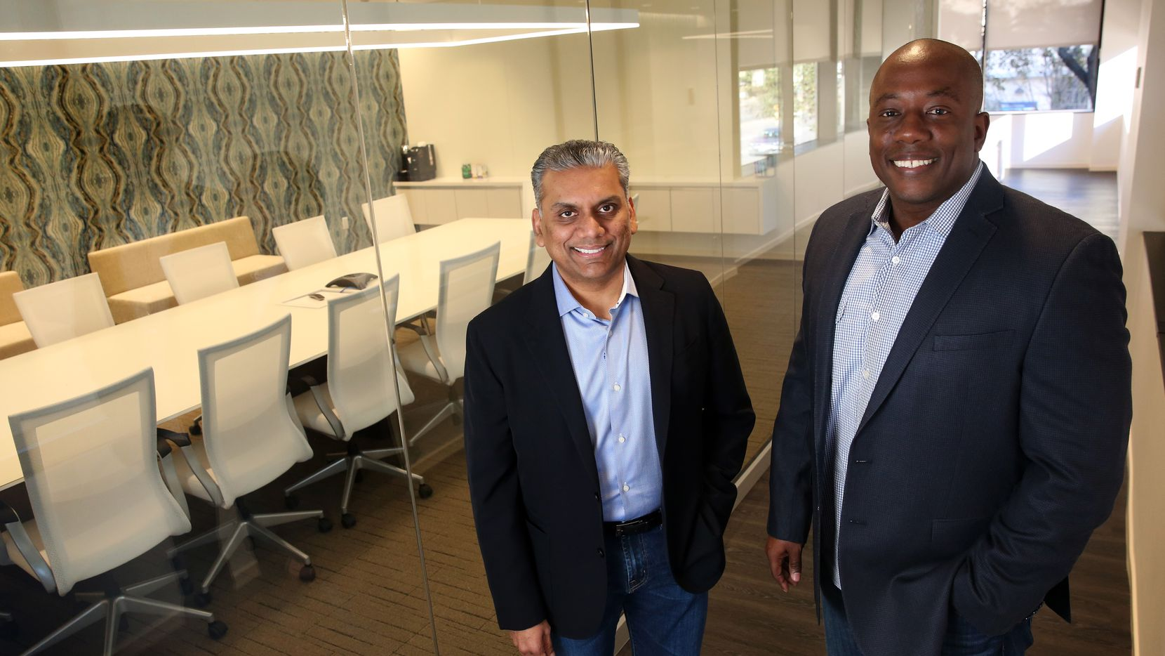 Business partners Anurag Jain (left) and Joe Beard pose for a photograph at Perot Jain, a tech investment firm, in Dallas on Thursday, Feb. 9, 2017. (Rose Baca/The Dallas Morning News)